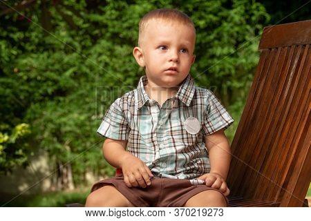 Little boy sitting on a chair