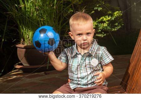 Little boy with a ball
