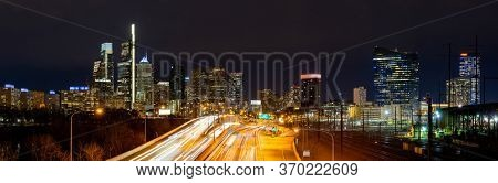 Panorama of Philadelphia skyscraper Skylines building at night illuminated with highway urban road transportation in Philly city downtown of Philadelphia in PA USA. Cityscape Urban lifstyle concept.