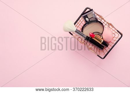 Shopping Cart With Makeup Cosmetics On Pink Background. Top View. Banner Mockup For Beauty Shop, Sho