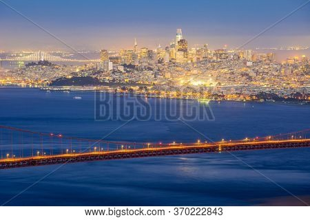 Sunset Golden Gate bridge Viewpoint with beautiful cityscape San Francisco skylines North California USA West Coast of Pacific Ocean, United States Landmark Travel Destination and cityscape concept.