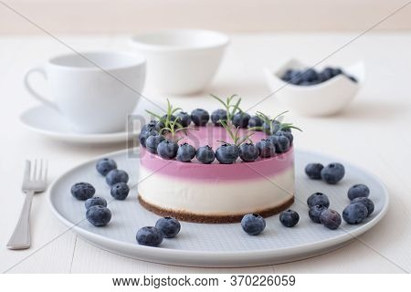 The Two-color Blueberry Mini Cheese Cake. Round No Bake Cheesecake, Bowl With Blueberries, Cup Of Co