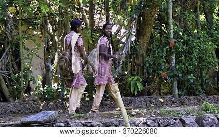Alleppey, India - March 11, 2014: Girls In Uniform Going Home After School In Rural Town Located In