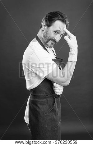 Serious About Keeping Germs Away. Thoughtful Cleaner Red Background. Home Hygiene. Mature Man Wear H