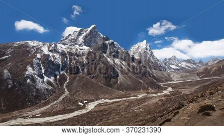 Himalayan Mountain Landscape With Panoramic View Of Cholatse And Taboche Mountains On The Road To Ev
