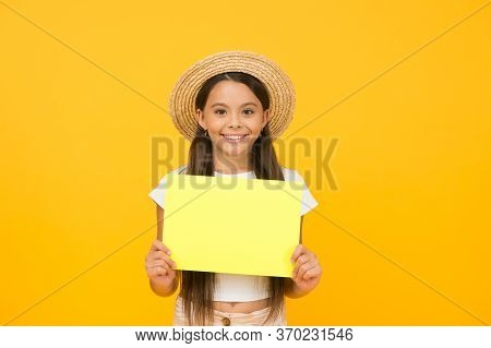Smiling Little Girl Holding Paper Sheet. Place For Copy Space. Go Shopping For Summer Attributes. Wh