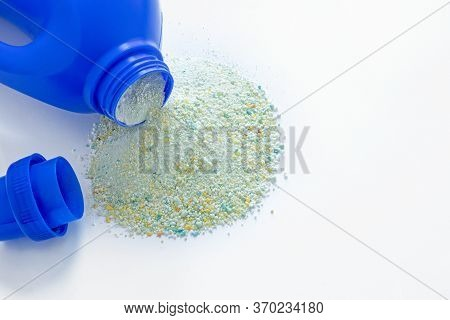 Powder For Dishwasher Texture, Close-up, Isolated On A White Background, Blue Plastic Container With
