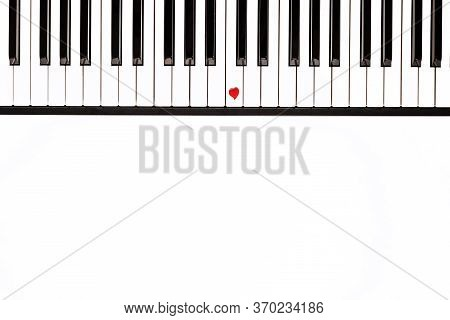 White And Black Piano Keys, A Small Red Heart On One Of The Keys, Musical Background, Concept Of Lov