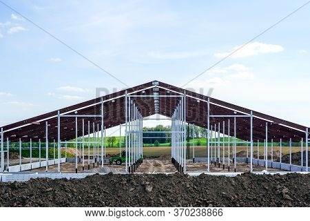 View Of A New Metal Frame Structure Of An Agricultural Building Under Construction