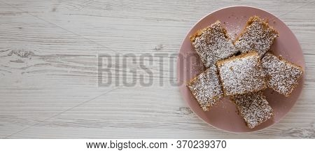 Homemade Tasty Applesauce Cake On A Pink Plate On A White Wooden Background, Top View. Flat Lay, Ove