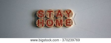 Covid-19 Pandemic Coronavirus Concept. Wooden Circles With The Inscription Stay Home On White Fone.