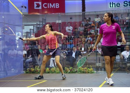 DAMANSARA - SEP 14: Low Wee Wern (orange) plays Raneem El Weleily in the women's semi-final of the CIMB Malaysian Open Squash Championships 2012 held in Damansara, Malaysia on September 14, 2012.