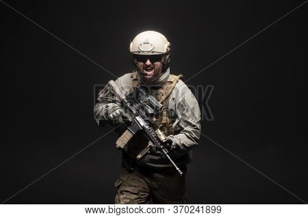 American Commando In Military Equipment And Arms Running At Night, Ranger Screaming In The Dark, Eli