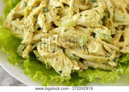 Homemade Coronation Chicken Salad On A White Plate, Low Angle View. Close-up.