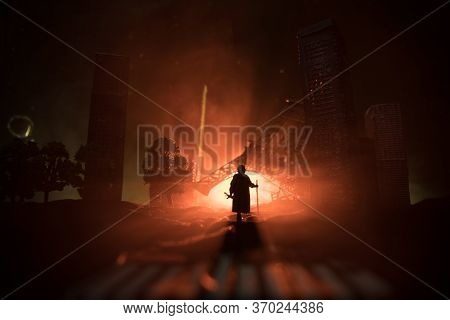 Empty Street Of Burnt Up City, Flames On The Ground And Blasts With Smoke In The Distance. Apocalypt