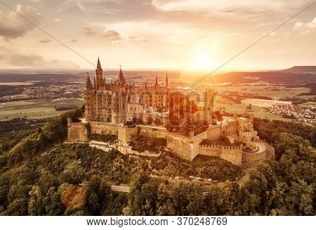 Burg Hohenzollern At Sunset, Germany. This Castle Is Famous Landmark In Stuttgart Vicinity. Landscap