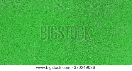 Uniform Granular Structure Of Green Color Wall