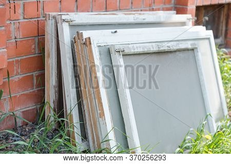 Old Window Frames. Window Frames Are On The Street. Glass Windows. Carry Out Repairs At Home. Window