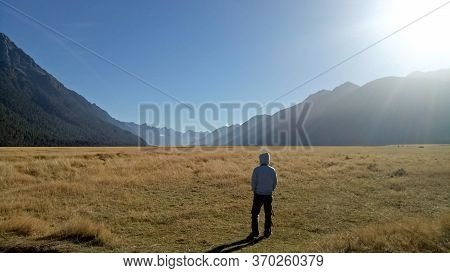Milford Sound, New Zealand - April 08, 2017 : A Man Standing On The Field On The Way To Milford Soun