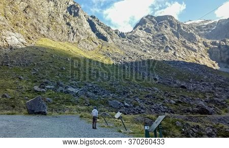 Fiordland, New Zealand - April 09, 2017 : A Man Walking Around Fiordland National Park South Island