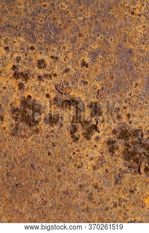 Very Rusty Orange Metal Surface With A Lot Of Damage And Traces Of Oxidation, Rust Is Strong, Closeu