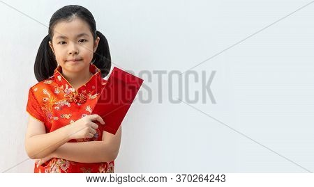 Asian Girl Wear Cheongsam And Take Red Envelopes In Chinese New Year