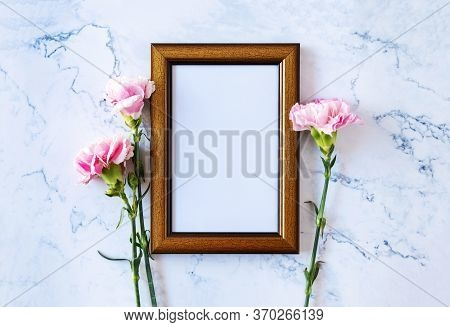 Carnation Flower On Blank Picture Frame On Marble Background, Valentine's Day, Mother's Day Or Birth