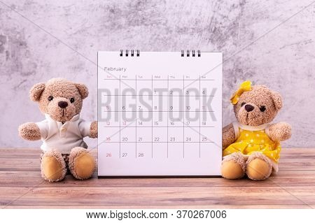 Couple Teddy Bear With Calendar On Table Wooden. Valentine's Day Celebration