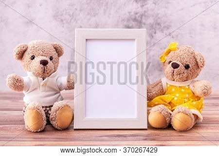 Couple Teddy Bear With Picture Frame On Table Wooden. Valentine's Day Celebration