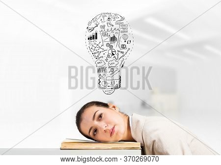 Bored Business Woman Lying On Desk With Open Book. Young Tired Student Trainee In White Business Sui