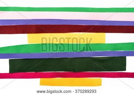 Multi-colored Strips Of Felt Fabric Horizontally On A White Background. Type Of Felt, Non-woven Mate