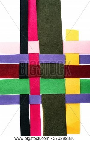 Threaded Multi-colored Strips Of Felt Fabric Horizontally On A White Background. Type Of Felt, Non-w