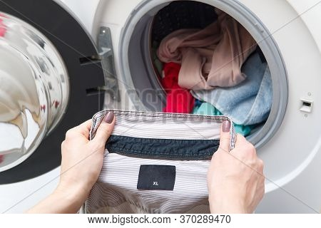 Housekeeper Has A Laundry Day At Home, She Takes The Laundry Or Whites Out Of Your Washing Machine O
