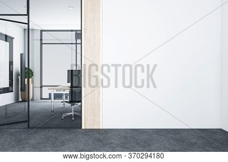 Modern Office With Computers On Desk And Empty White Wall. Workplace And Company Concept.  3d Render