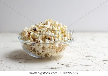 Popcorn In A Transparent Glass Bowl On White Table