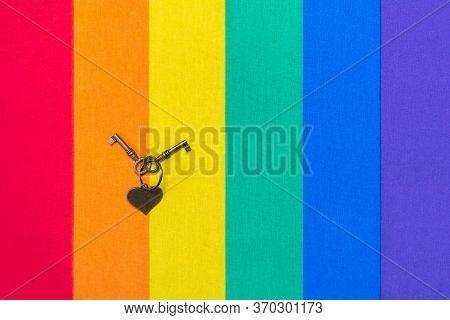 Metal Heart And Keys On Rainbow Flag Pattern Of Fabric Texture For Lgbtq. Rainbow Flag Of Fabric Tex
