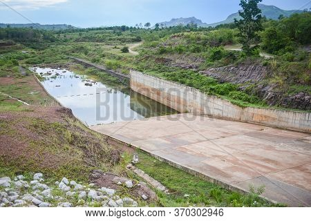 Drain Canal Behind The Dam Drains Excess Water From The Lake / Drainage Canal Reservoir