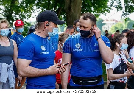 Uzhgorod, Ukraine - June 7, 2020: Police Officers In Medical Masks Talk Before The Start Of The Runn