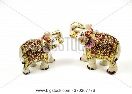 Marble Beautiful White Elephant Statuette With Red And Gold Painted Rhinestones, Isolated On A White