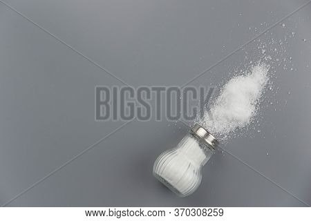 A Pile Of Salt From Salt Shaker, Concept Excessive Salt Intake And White Death