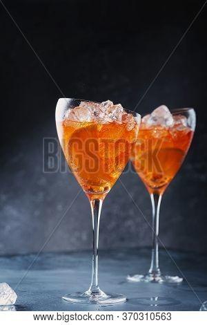 Traditional Italian Aperitif Aperol Spriz With Orange And Ice, Selective Focus
