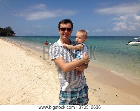 Dad with a baby on the beach