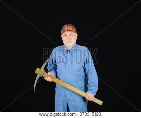 Male Laborer With Building Tools. Construction Worker Holds Pickaxe. Man Contractor With Axe. Smilin