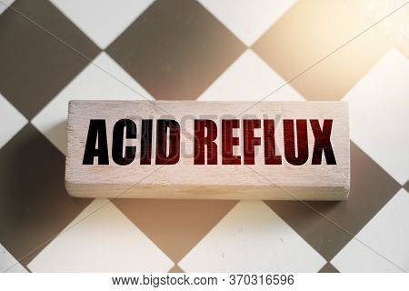 Wooden Block Form The Word Acid Reflux. Medical Concept