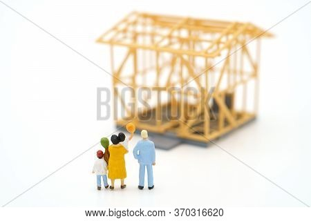 Miniature People Standing Check The Quality In The Home. Concept Of Buying A New Home .home Inspecti