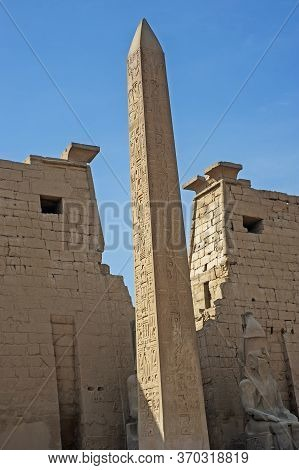 Large Tall Ancient Egyptian Obelisk At The Entrance Pylon To Temple Of Luxor With Hieroglyphic Carvi