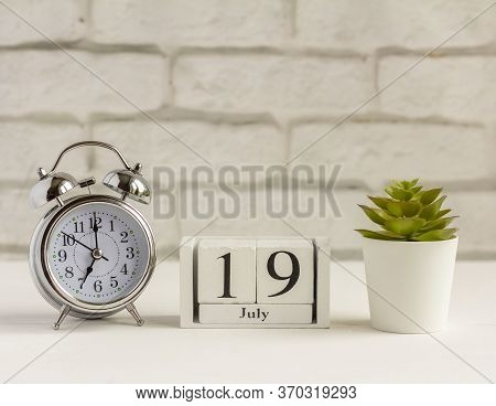 June 19 According To The Wooden Calendar. Summer Day, Empty Space For Text.calendar For June On A Li
