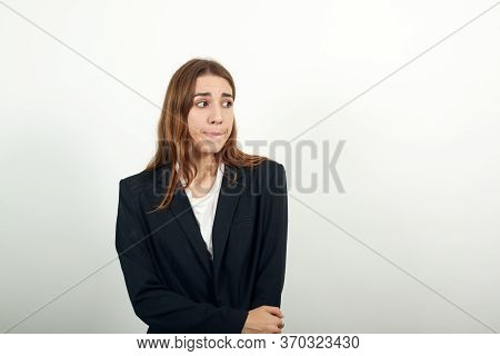 Bitting Mouth And Looking Worried, Scared Crossing Arms, Worry, Doubt. Anxious Thinking Guessing, St