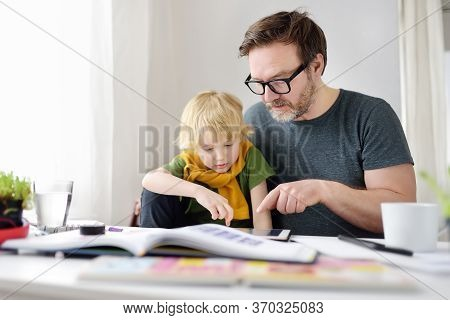 Father Helping Child Do Homework At Home. Homeschooling, Distance Learning, Online Studying, Remote