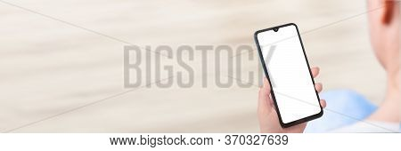 Woman Sitting And Holding Blank Screen Mockup Mobile Phone. Hand Holding Cell Phone With Blank Scree